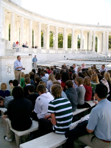 Don Cole addresses the students in Memorial Ampitheater