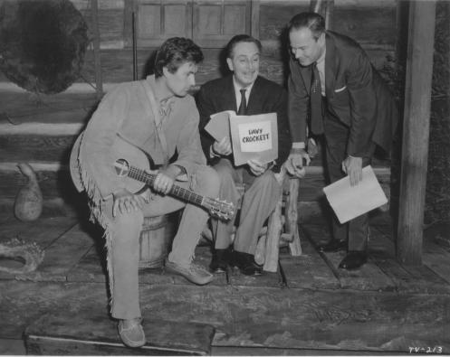 Walt Disney reviews the Davy Crockett script with his director and the film\'s star, Fess Parker
